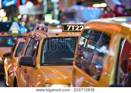 NEW YORK CITY - AUG. 26 : Yellow Taxi on Times Square in Manhattan on August 26 2017 in New York City NY. Times Square is a major tourist destination and entertainment center.