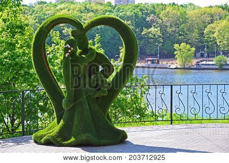 Khimki, Russia - May 30.2017. sculpture of butterfly and peafowl in the park Eco shore