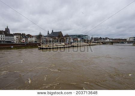 MAASTRICHT NETHERLANDS - JANUARY 09 2015: View of Maastricht city centre and the Meuse river. Maastricht is the oldest city of the Netherlands and the capital city of the province of Limburg.