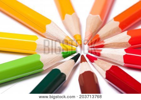 Pencils stacked in a circle. Warm colors. A bright picture on the theme of drawing education school creativity