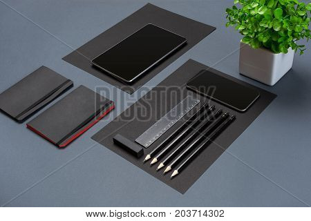 Modern mock up flat lay of notebook and stationery on gray background. Concept of creative work space
