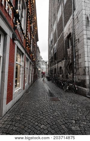 MAASTRICHT NETHERLANDS - JANUARY 09 2015: The streets in the historic center. Stylization. Maastricht is the oldest city of the Netherlands and the capital city of the province of Limburg.