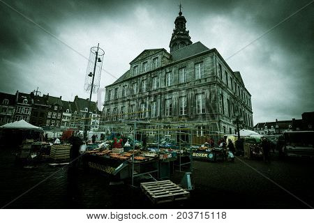MAASTRICHT NETHERLANDS - JANUARY 09 2015: Town Hall and Market Square in the historic center. Vintage stylization. Vignetting. Maastricht is the oldest city of the Netherlands and the capital city of the province of Limburg.