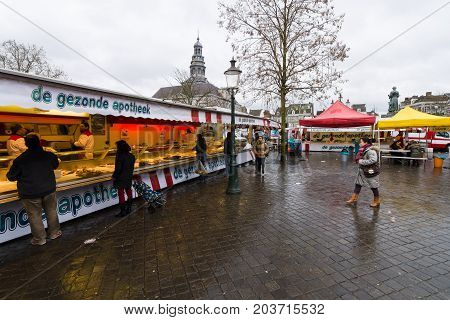 MAASTRICHT NETHERLANDS - JANUARY 09 2015: Fish Market in the market square in the historic center. Maastricht is the oldest city of the Netherlands and the capital city of the province of Limburg.