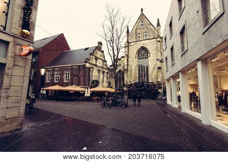 MAASTRICHT NETHERLANDS - JANUARY 09 2015: The streets in the historic center. Vintage toning. Stylization. Maastricht is the oldest city of the Netherlands and the capital city of the province of Limburg.