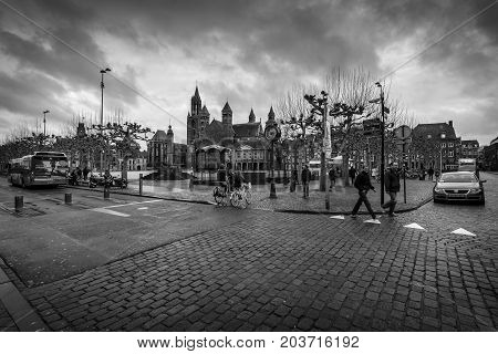 MAASTRICHT NETHERLANDS - JANUARY 09 2015: Vrijthof square. In the background Evangelical Church of John the Baptist and the Basilica of Saint Servatius. Black and white.
