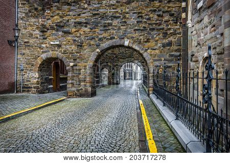 MAASTRICHT NETHERLANDS - JANUARY 09 2015: Old cobbled streets. Maastricht is the oldest city of the Netherlands and the capital city of the province of Limburg.