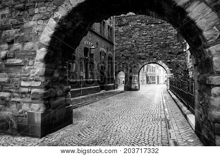 MAASTRICHT NETHERLANDS - JANUARY 09 2015: Old cobbled streets. Black and white. Maastricht is the oldest city of the Netherlands and the capital city of the province of Limburg.