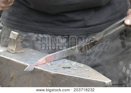 Blacksmith Wotk With Hammer And Hot Iron