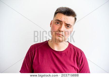 A portrait of a man showing emotions