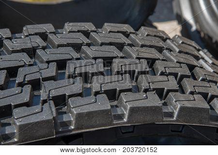 Tread pattern of automotive black rubber tire close-up