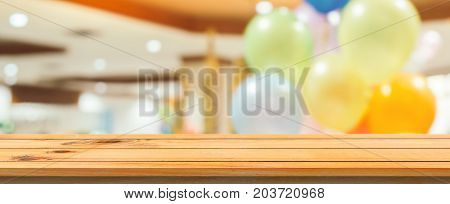 Wooden board empty table blurred background. Perspective brown wood over blur in department store - can be used for display or montage your products. Mock up for display of product