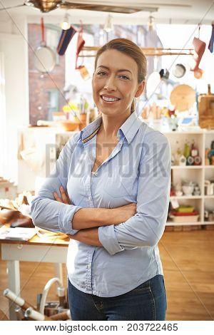 Portrait Of Businesswoman Srtanding In Cook Shop
