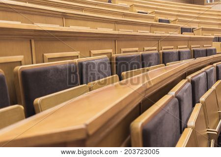Side view close up of comfortable seats and tables in auditory room at university