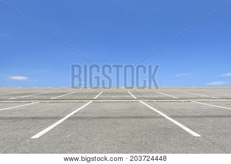 Empty parking lot against a beautiful blue sky