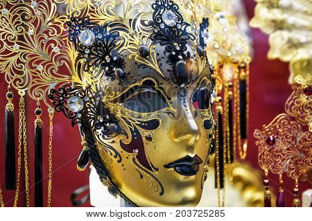 Traditional venetian mask in Venice, Italy. Venetian carnival is an annual costume festival which attracts many tourists.