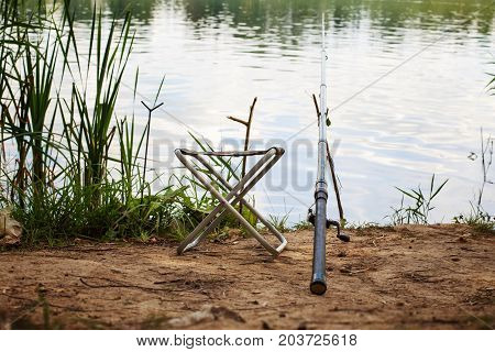 a fishing pole on the river bank