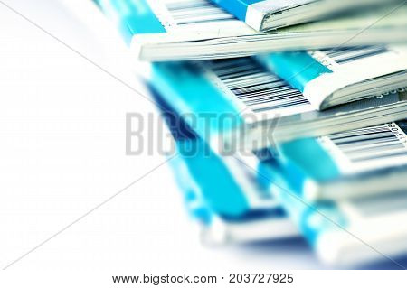 Close up part of barcode on blue magazine stacking with white background background for copyright article concept