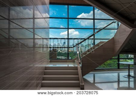 Luxury staircase in office buildings with cityscape over from windows glass indoor stairs