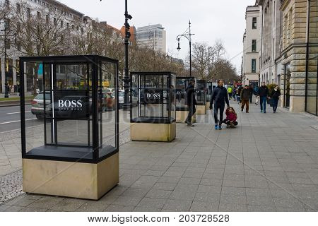 BERLIN - FEBRUARY 22 2015: Outdoor advertising Hugo Boss in the famous shopping street - Kurfuerstendamm. Hugo Boss AG is a German luxury fashion and style house.