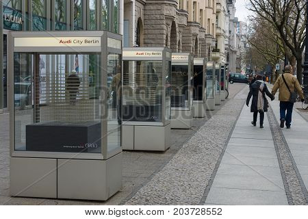 BERLIN - FEBRUARY 22 2015: Outdoor advertising Audi on the famous shopping street - Kurfuerstendamm. Audi AG is a automobile manufacturer that designs engineers and produces luxury automobiles.