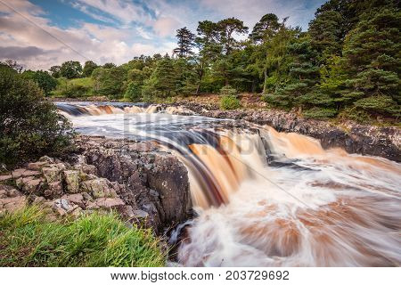 River Tees cascades over Low Force, and the Whin Sill at Low Force Waterfall with the Pennine Way following the southern riverbank poster