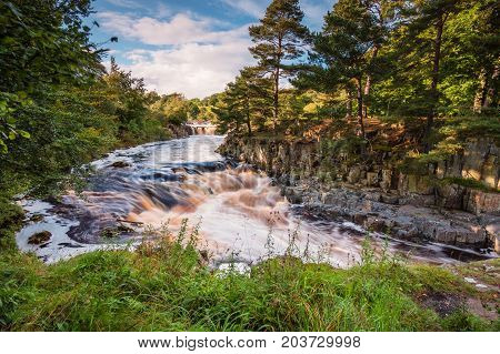 River Tees below Low Force, as it cascades over the Whin Sill at Low Force Waterfall, with the Pennine Way following the southern riverbank