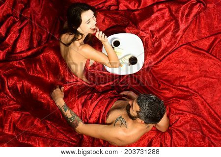 Man And Woman With Half Covered Bodies Drink Coffee