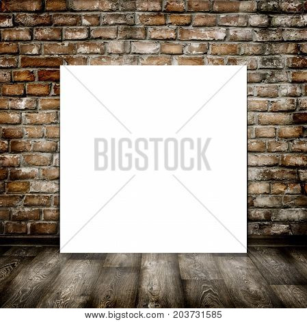 Empty poster in old interior with brick wall and wood floor