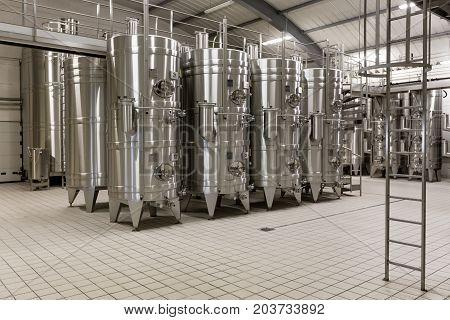 Barrels For Wine storage Modern Development Technology Concept. Inside modern wine factory