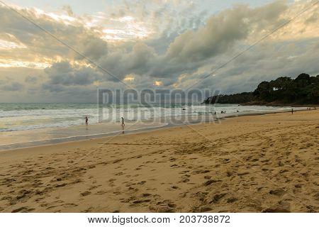 Dramatic sky and tropical beach at Surin beach Phuket island Thailand