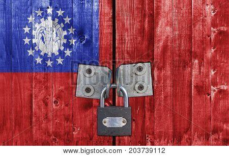 Burma flag on door with padlock close