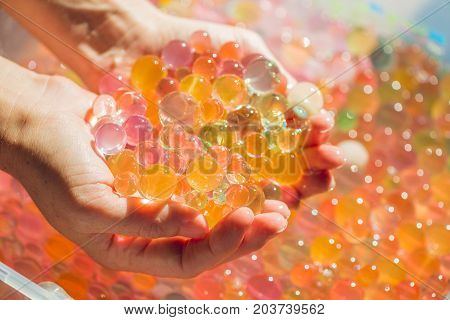 Colored Balls Of Water Beads, Hydrogel In In Hands. Sensory Experiences