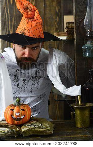 Man With Beard On Wooden Background. Man In Orange Hat
