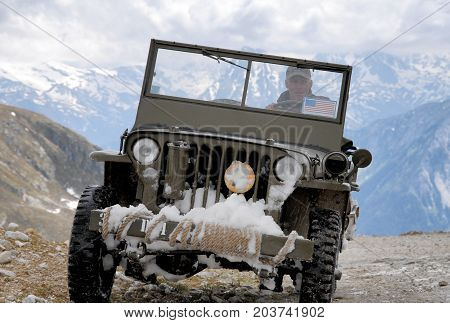 an old fighting jeep in the mountain