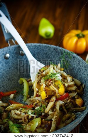 Eggplant With Vegetables Fried In A Wok