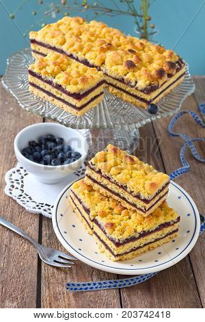 Pieces of layer blueberry cake with crumble