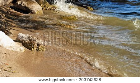 Waves rolling up to a rocky shoreline