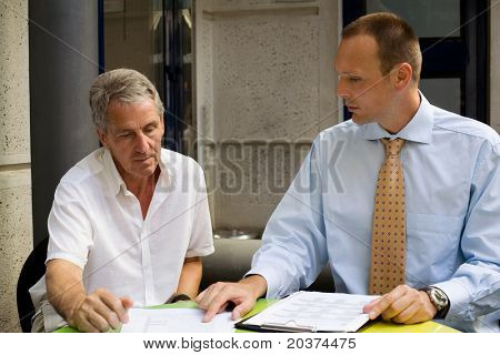 two businessmen at the meeting