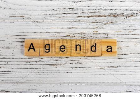 AGENDA word made with wooden blocks concept