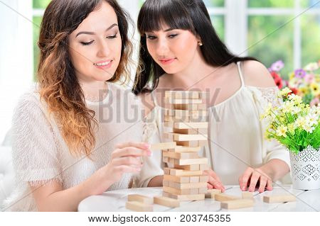 Portrait of a happy women playing with blocks together