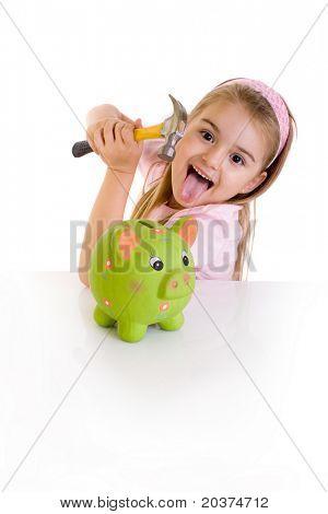 schoolgirl about to break the piggy bank