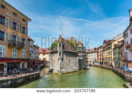 Annecy France - May 25 2016: The picturesque medieval prison in the old French resort town of Annecy in the center. Today it is a museum. The building looks great in the middle of a large city canal.
