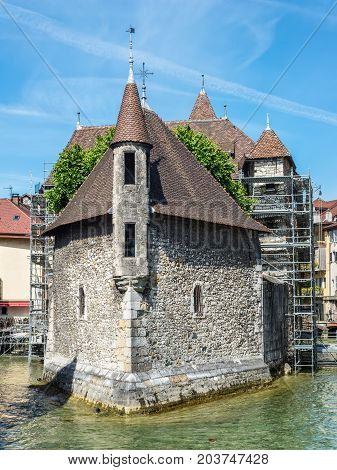 Annecy France - May 25 2016: The picturesque medieval prison in the old French resort town of Annecy. Today it is a museum. The building looks great in the middle of a large city canal (Thiou river).