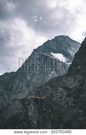 Sunlight On Alpine Valley With Glowing Mountain Peaks And Scenic Clouds. Italian French Alps, Summer