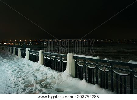 Winter nature night river and coast in snow