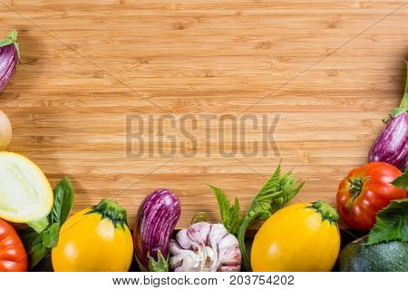 Bamboo plate copy space, restautant concept with fresh colorful organic vegetables - round courgette small eggplants tomatoes diet concept Italian and French food healthy food. Menu template. Weigthloss.