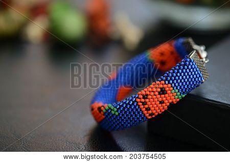 Halloween pumpkin bracelet on a dark background poster