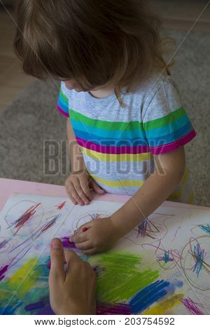children learning for coloring or hand drawing paint on white paper and colorful table.