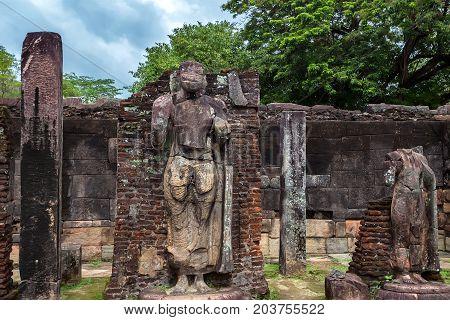 Statue of standing Buddha in Hatadage in Polonnaruwa ruins. Unesco world heritage on Sri Lanka.